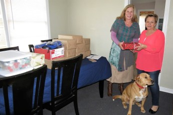 Lion Pam, on the left, with ISC representative Vicki West and her dog Buddy.