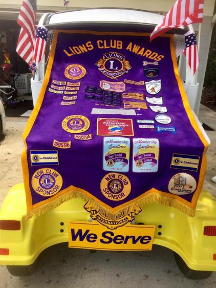 The Club's banner on the back of the cart
