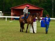 A camper riding a horse